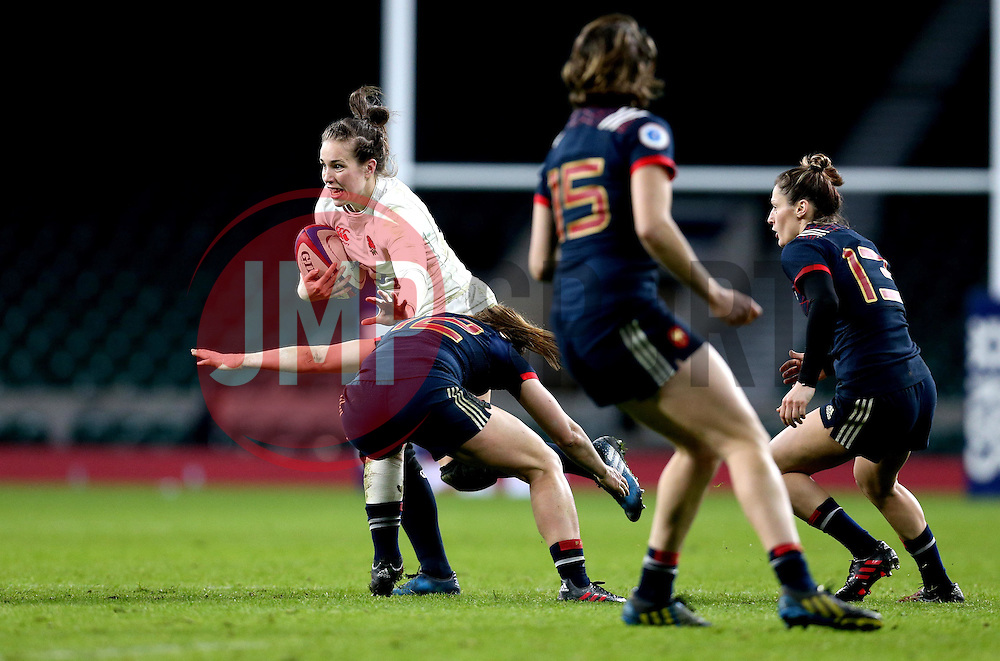 Emily Scarratt of England is tackled by Elodie Poublan of France Women - Mandatory by-line: Robbie Stephenson/JMP - 04/02/2017 - RUGBY - Twickenham - London, England - England v France - Women's Six Nations