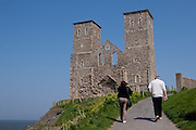 Tourist walk up to the ruins of a 14th Century church on a cliff top in Reculver Country Park at Reculver near Herne Bay in Kent. UK Wednesday May 7th 2008