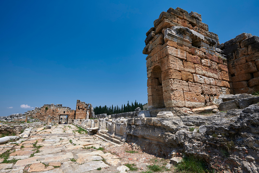 Picture of the Nymphaeum located inside the sacred area in front of the Apollo temple on the main colonnaded road. Dated from the 2nd century AD and repaired in the 5th century during the Byzantine era. Hierapolis archaeological site near Pamukkale in Turkey. .<br /> <br /> If you prefer to buy from our ALAMY PHOTO LIBRARY  Collection visit : https://www.alamy.com/portfolio/paul-williams-funkystock/pamukkale-hierapolis-turkey.html<br /> <br /> Visit our TURKEY PHOTO COLLECTIONS for more photos to download or buy as wall art prints https://funkystock.photoshelter.com/gallery-collection/3f-Pictures-of-Turkey-Turkey-Photos-Images-Fotos/C0000U.hJWkZxAbg