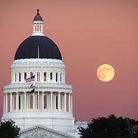 Full moon rising next to the California state capitol, Sacramento, California.