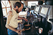 A rancher in Halfway, Oregon, Bob Goodman lost his arm below his elbow in a freak accident. Researchers at the University of Utah attached a myoelectric arm, which he controls by flexing the muscles in his arm that are still intact. Sensors on the inside of the prosthetic arm socket pick up the faint electrical signals from the muscles and amplify them to control the robot arm. In this way, Goodman can cook his dinner and do his chores, just as he did before the accident. From the book Robo sapiens: Evolution of a New Species, page 179 top.