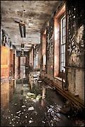 Flooded asylum corridor with windows and doors