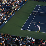 Leonardo Mayer, Argentina, in action against Andy Murray, Great Britain, in front of a packed Louis Armstrong Stadium during the Men's Singles competition at the US Open. Flushing, New York, USA. 30th August 2013. Photo Tim Clayton