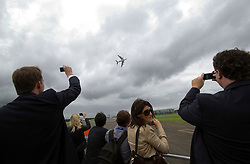 © London News Pictures. 09/07/2012. Farnborough, UK. Businessman and women watch a Malaysian Airlines Airbus A380 giving a flight demonstration on day one of the Farnborough International Airshow, in Farnborough, Hampshire, UK on July 9, 2012. FIA is a seven-day international trade fair for the aerospace industry which is held every two years at Farnborough Airport . Photo credit: Ben Cawthra/LNP.