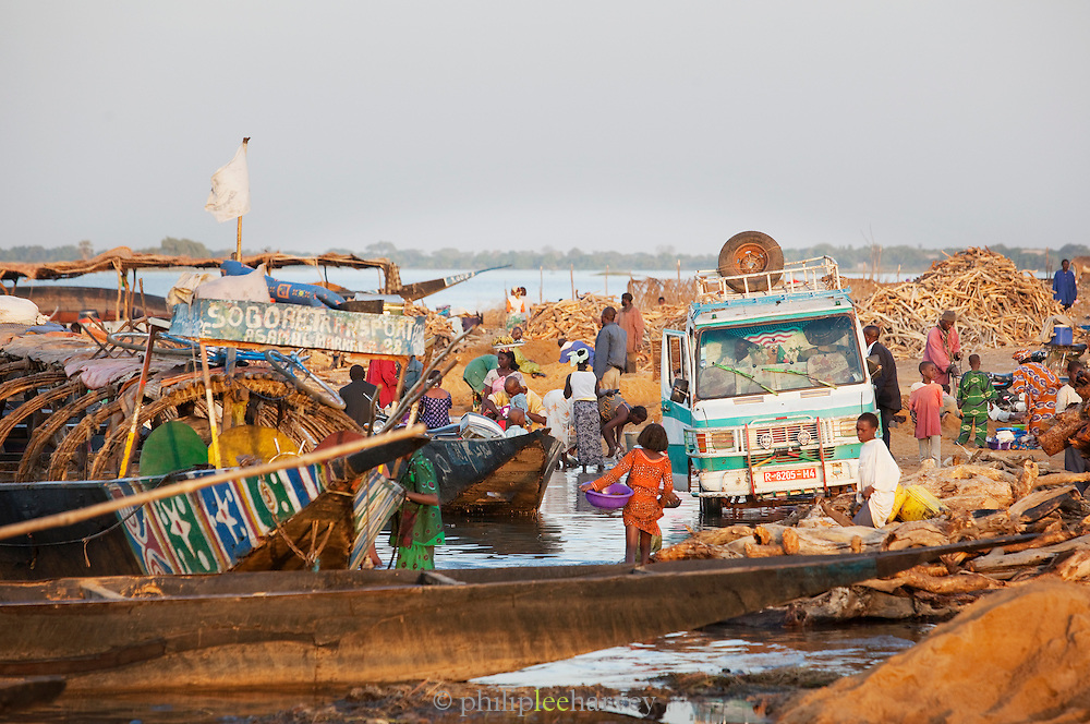 Many people working on the banks of the Niger River at Segou, Mali