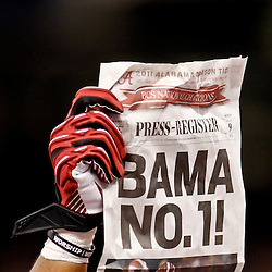Jan 9, 2012; New Orleans, LA, USA; A Alabama Crimson Tide players raises  a Press-Register newspaper in celebration after the 2012 BCS National Championship game win over the LSU Tigers at the Mercedes-Benz Superdome.  Mandatory Credit: Derick E. Hingle-US PRESSWIRE