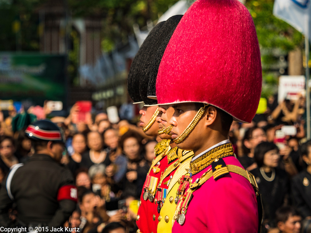 16 DECEMBER 2015 - BANGKOK, THAILAND:  A Thai military honor guards lead the funeral procession for Somdet Phra Nyanasamvara, who headed Thailand's order of Buddhist monks for more than two decades and was known as the Supreme Patriarch. The Patriarch died in 2013. He was ordained as a Buddhist monk in 1933 and appointed as the Supreme Patriarch in 1989. He was the spiritual advisor to Bhumibol Adulyadej, the King of Thailand when the King served as a monk in 1956. Tens of thousands of people lined the streets during the procession to pray for the Patriarch.    PHOTO BY JACK KURTZ