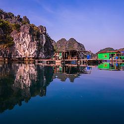 Floating Fishing Villages, Cat Ba islands (Hai Phong Province). Limestone cliffs