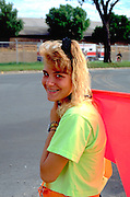 17 year old girl directing traffic at State Fair.  St Paul Minnesota USA