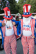 Men dressed in Uncle Sam costumes get ready for the annual Independence Day parade July 4, 2019 in Sullivan's Island, South Carolina. The tiny affluent Sea Island beach community across from Charleston holds an outsized golf cart parade featuring more than 75 decorated carts.