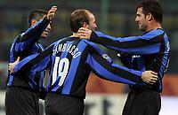 20/11/2005<br /> <br /> Inter Parma 2-0<br /> <br /> Il giocatore dell'Inter Mattias Cambiasso (centro) viene festeggiato dai compagni Ramiro Cordoba (s) e Dejan Stankovic <br /> <br /> Inter Esteban Cambiasso (L2) celebrate after scoring with his teammates Ramiro Cordoba (L) Dejan Stankovic (R2) <br /> <br /> Photo Milanofoto/Graffiti
