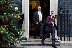© Licensed to London News Pictures. 05/12/2017. London, UK. Defence Secretary Gavin Williamson (R) leaves 10 Downing Street after the weekly Cabinet meeting. Photo credit: Rob Pinney/LNP