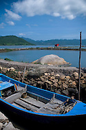 Landscape of a boat with pounds and mountains in background. Nha Trang, Khanh Hoa area, Vietnam, Asia.