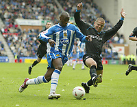 Fotball<br /> England 2004/2005<br /> Foto: SBI/Digitalsport<br /> NORWAY ONLY<br /> <br /> Wigan Athletic v Reading<br /> Coca-Cola Championship<br /> 08/05/2005<br /> <br /> Wigan's Nathan Ellington crooses the ball past Reading's Andy Hughes to set up the first goal