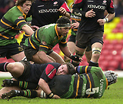 Watford, GREAT BRITAIN, 15th Feburary 2004, Vicarage Road, ENGLAND. [Mandatory Credit: Photo  Peter Spurrier/Intersport Images],<br /> 15/02/2004  -  Zurich Premiership, Saracens v Northampton Saints<br /> Saints mark Conners is grounded, as Andrew Blowers moves in the form the ruck and recycle the ball.