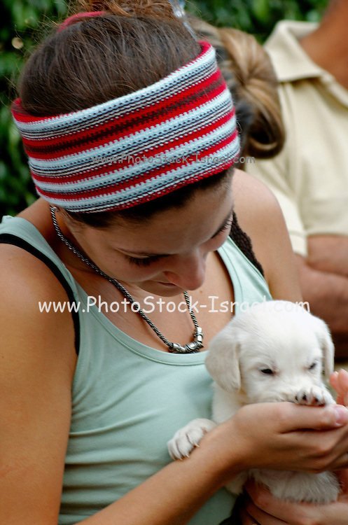 A young woman and a young puppy