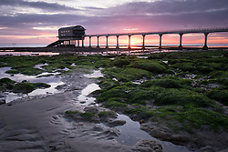 © Licensed to London News Pictures. 08/04/2016. Bembridge, UK. Sunrise at Bembridge RNLI lifeboat station on the Isle of Wight this morning, Thursday 8th April 2016. Photo credit : Rob Arnold/LNP