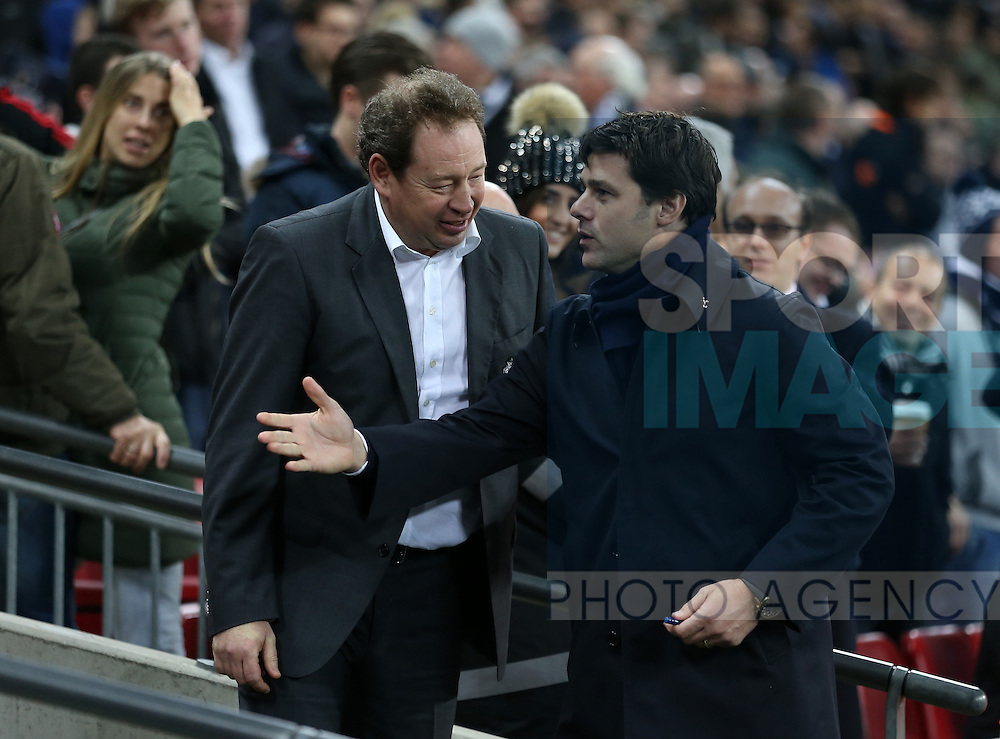 Tottenham's Mauricio Pochettino with CSKA Moscow's Leonid Slutski during the Champions League group match at Wembley Stadium, London. Picture date December 7th, 2016 Pic David Klein/Sportimage