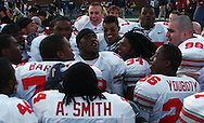 MORNING JOURNAL/DAVID RICHARD.Quarterback Troy Smith, center, and the Buckeyes celebrate at midfield after the game.
