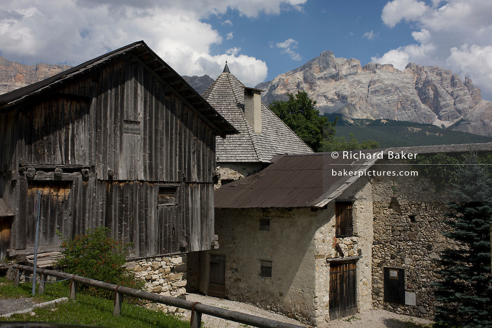 Old barn and Dolomites house in La Villa, in Alta Badia, south Tyrol, Italy.