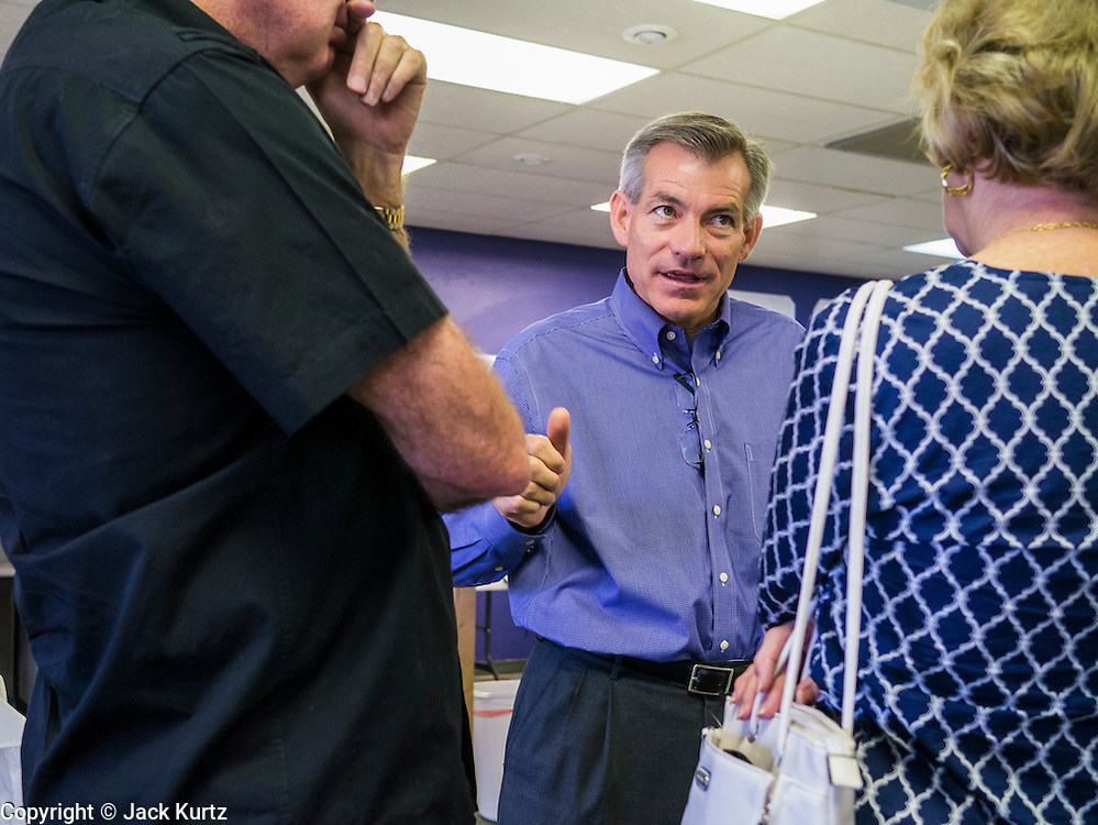 02 JUNE 2012 - PHOENIX, AZ:  Congressman DAVID SCHWEIKERT (R-AZ) talks to campaign volunteers Saturday. Schweikert met with his campaign staff and volunteers for a pancake breakfast Saturday morning at the campaign headquarters to talk to them about the upcoming primary election against fellow Republican Ben Quayle. Republican incumbents Schweikert and Quayle will face each other in Arizona's Aug. 28 primary election. Redistricting because of the census has thrown the two conservative freshman Republican Congressmen into Arizona's 6th Congressional District. The district is made up of mostly upper middle class neighborhoods in north Phoenix and the wealthy suburban communities of Scottsdale, Fountain Hills and Cave Creek. The District is strongly Republican and whoever wins the Republican primary is expected to easily win November's general election.       PHOTO BY JACK KURTZ