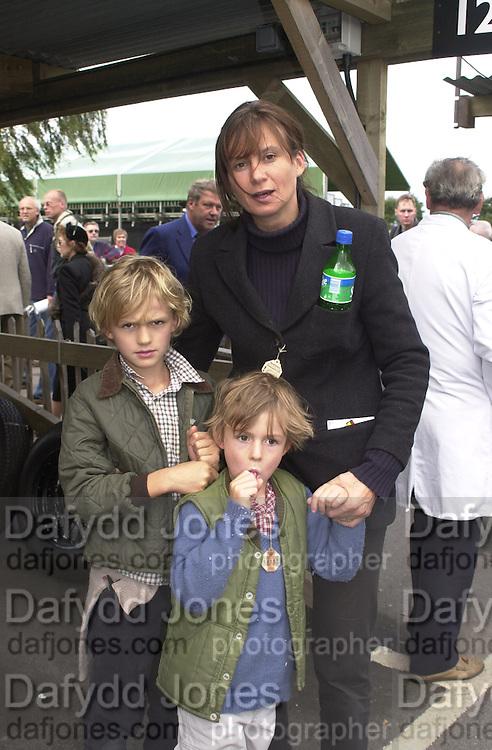 Charlotte Blacker with Tom and Ruipert. Goodwood Revival Meeting. 16 September 2000. © Copyright Photograph by Dafydd Jones 66 Stockwell Park Rd. London SW9 0DA Tel 020 7733 0108 www.dafjones.com