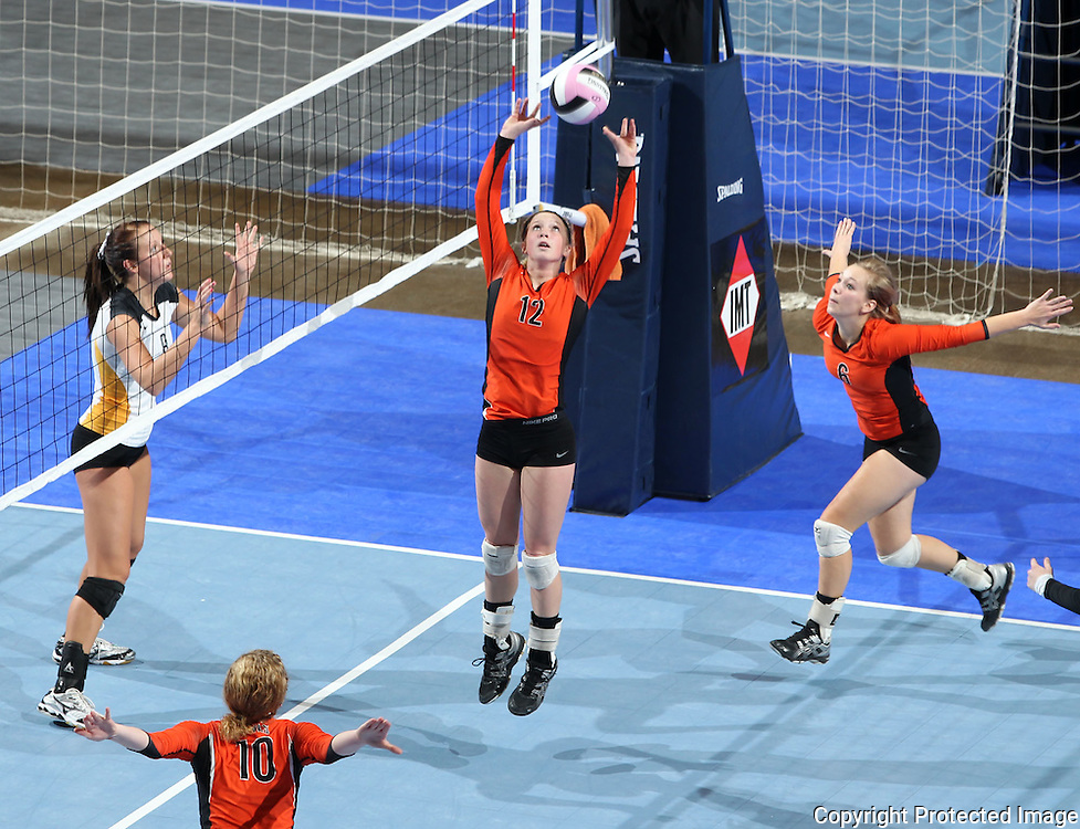 West Delaware's Jenna Hermsen (12) sets the ball for Mackenzie Harbaugh (6) during the second game of a 3A semifinal in the state volleyball tournament at the U.S. Cellular Center at 370 1st Ave E on Friday afternoon, November 12, 2010. (Stephen Mally/Freelance)