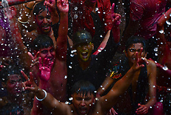 March 23, 2019 - Allahabad, India - Indian revellers dance and celebrate the holi festival in the old streets of Allahabad on March 23, 2019. Holi , the populer hindu spring festival of colours is observed in India and across the countries at the end of the winter season on the last full moon of the luner month. (Photo by Ritesh Shukla  (Credit Image: © Ritesh Shukla/NurPhoto via ZUMA Press)
