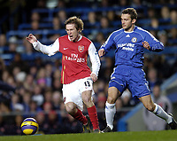 Photo: Olly Greenwood.<br />Chelsea v Arsenal. The Barclays Premiership. 10/12/2006. Arsenal's Alexander Hleb and Chelsea's Andriy Shevchenko