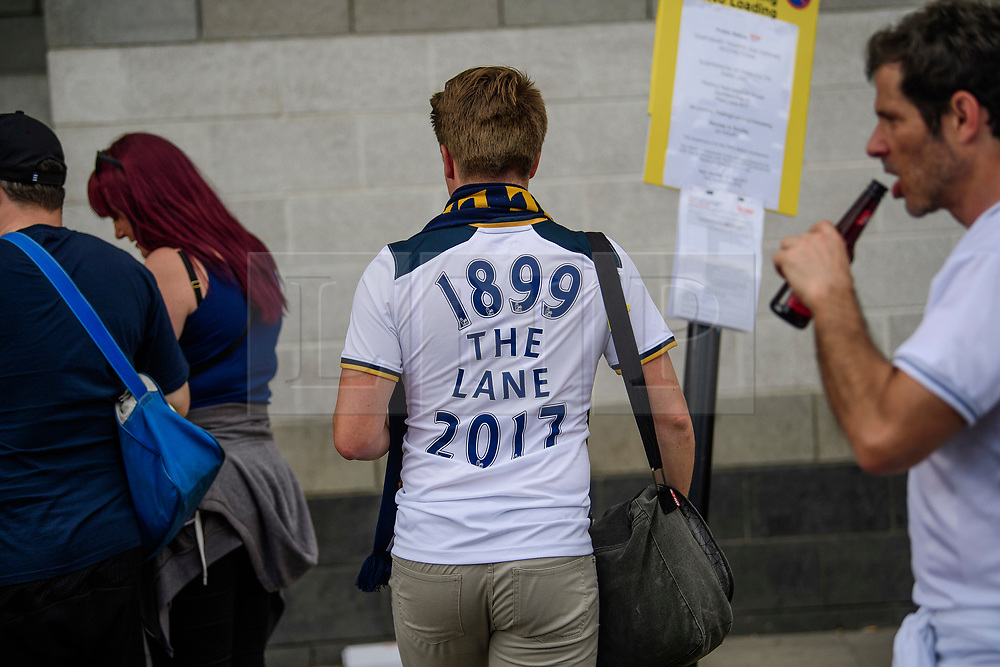 """© Licensed to London News Pictures. 14/05/2017. London, UK. A supporter wearing a shirt reading """"1899 THE LANE 2017"""" enters White Heart Lane, in North London where Tottenham Hotspur F.C. are playing their final game at the ground, against Manchester united today (Sun). Known as 'The Lane', Tottenham have been playing at the ground for 118 years, but will be playing at Wembley next season while a new 60,000 seat stadium is built for the start of the 2018/19 season.  Photo credit: Ben Cawthra/LNP"""