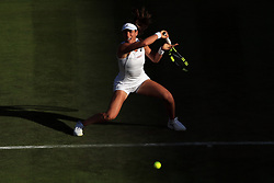 3 July 2017 -  Wimbledon Tennis (Day 1) - Johanna Konta (GBR) in action in the late afternoon sun - Photo: Marc Atkins / Offside.