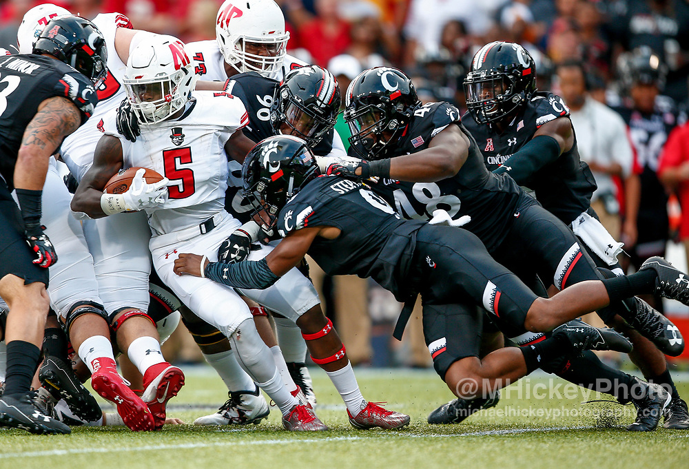 CINCINNATI, OH - AUGUST 31: Kentel Williams #5 of the Austin Peay Governors is tackled by a host of Cincinnati Bearcats defenders during the game at Nippert Stadium on August 31, 2017 in Cincinnati, Ohio. (Photo by Michael Hickey/Getty Images)  *** Local Caption *** Kentel Williams