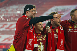 """LIVERPOOL, ENGLAND - Wednesday, July 22, 2020: Liverpool's manager Jürgen Klopp sings """"You'll Never Walk Alone"""" with his staff after being crowned Premier League champions after the FA Premier League match between Liverpool FC and Chelsea FC at Anfield. The game was played behind closed doors due to the UK government's social distancing laws during the Coronavirus COVID-19 Pandemic. Liverpool won 5-3. (Pic by David Rawcliffe/Propaganda)"""