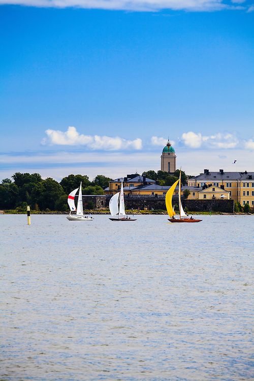 Wooden sailing boats in front of Suomenlinna in Helsinki, Finland. The  Viapori Trophy Race around Suomenlinna sea fortress, is the biggest sailing competition for wooden sailing boats in the Nordic countries.