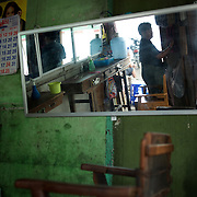May 15, 2013 - Meiktila, Myanmar: A barber shop in a residential neighbourhood severely destroyed by anti-muslim violence in Meiktila, central Myanmar. CREDIT: Paulo Nunes dos Santos