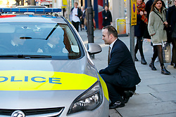 © Licensed to London News Pictures. 04/12/2015. London, UK. Labour MP Neil Coyle, who voted for Syria airstrikes talking to police officers protecting his office during his surgery in Bermondsey after receiving death threats on Twitter on Friday, 4 December 2015. Photo credit: Tolga Akmen/LNP