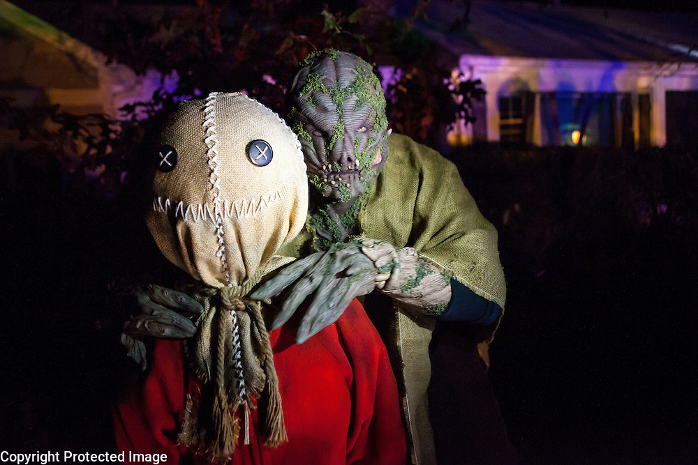 """Chris Baker is photographed with """"Sam"""" from the cult classic movie """"Trick 'r Treat"""" in his haunted yard in South Yarmouth, MA. Every year Baker sets up an elaborate Halloween display in his yard and on Halloween, neighborohood residents walk through his frightening """"vortex"""" of horror while trick or treating."""