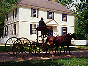 Horses with buckboard at Colonial Williamsburg, the restored eighteenth-century capital of Virginia.