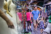 01 APRIL 2013 - BANGKOK, THAILAND:   Tim and Arielle Hupe walk through a Bangkok market on their way to dinner.  PHOTO BY JACK KURTZ