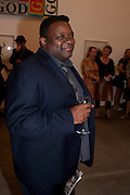 ISAAC JULIEN, Artists for Women for Women International, A PRIVATE VIEW AND LAUNCH RECEPTION OF LEADING CONTEMPORARY ARTISTS WHO HAVE DONATED WORKS TO BE AUCTIONED AT CHRISTIEÕS POST-WAR AND CONTEMPORARY SALE TO BENEFIT WOMEN FOR WOMEN INTERNATIONAL. Gagosian Gallery. Britannia St. London. 27 September 2011. <br /> <br />  , -DO NOT ARCHIVE-© Copyright Photograph by Dafydd Jones. 248 Clapham Rd. London SW9 0PZ. Tel 0207 820 0771. www.dafjones.com.<br /> ISAAC JULIEN, Artists for Women for Women International, A PRIVATE VIEW AND LAUNCH RECEPTION OF LEADING CONTEMPORARY ARTISTS WHO HAVE DONATED WORKS TO BE AUCTIONED AT CHRISTIE'S POST-WAR AND CONTEMPORARY SALE TO BENEFIT WOMEN FOR WOMEN INTERNATIONAL. Gagosian Gallery. Britannia St. London. 27 September 2011. <br /> <br />  , -DO NOT ARCHIVE-© Copyright Photograph by Dafydd Jones. 248 Clapham Rd. London SW9 0PZ. Tel 0207 820 0771. www.dafjones.com.