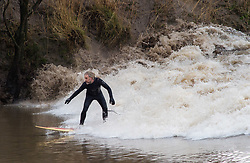 © Licensed to London News Pictures. 04/03/2018. Bristol, UK. Surfers ride the Severn Bore AT Newnham and Minsterworth, following the cold winter weather of the Beast from the East and Storm Emma. The bore this weekend is one of the highest of the year, a four star bore according to the height charts. Photo credit: Simon Chapman/LNP