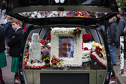 "© Licensed to London News Pictures . 28/08/2015 . Salford , UK . A portrait of Paul Massey on one of the hearses . The funeral of Paul Massey at St Paul's CE Church in Salford . Massey , known as Salford's "" Mr Big "" , was shot dead at his home in Salford last month . Photo credit : Joel Goodman/LNP"