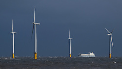 © Licensed to London News Pictures. <br /> 01/02/2015. <br /> <br /> South Gare, Redcar, United Kingdom<br /> <br /> The container ship Wilhelmine sails past the off shore wind farm as it approaches the mouth of the Tees at South Gare near Redcar in Teesside.<br /> <br /> Photo credit : Ian Forsyth/LNP