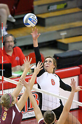 13 September 2011: Brooklyn Hlafka softly puts the ball over the net towards Melissa Hastings during an NCAA volleyball match between the Ramblers of Loyola and the Illinois State Redbirds at Redbird Arena in Normal Illinois.