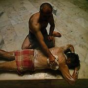 Getting treatment inside the ancient Emir Hammam in Mardin city.