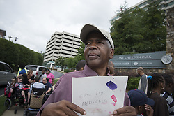 June 6, 2017 - Atlanta, GA - Dozens of Georgia residents with developmental challenges gather outside U.S. Senator Johnny Isakson's local office to protest  potential cuts to Medicaid waivers , cuts that would significantly diminish their quality of life from waiver-funded services. (Credit Image: © Robin Rayne Nelson via ZUMA Wire)