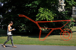 """© Licensed to London News Pictures. 05/07/2017. London, UK. """"Wheelbarrow"""", 2013, by Michael Craig-Martin. The Frieze Sculpture festival opens to the public in Regent's Park.  Featuring outdoor works by leading artists from around the world the sculptures are on display from 5 July to 8 October 2017.  Photo credit : Stephen Chung/LNP"""