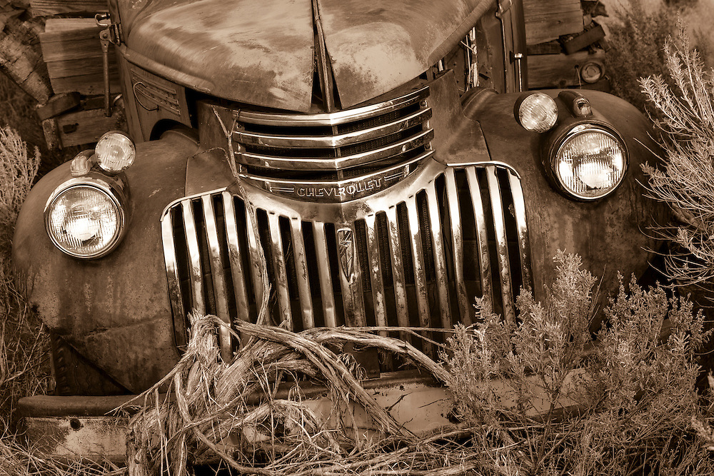 A 1946 Chevy truck lies abandoned in the sage brush of Oregon's high desert after a hard life of work on an old homestead farm.