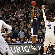Ryan Boatright, UConn, shoots for three over Marquel Curtis, Tulsa, during the UConn Huskies Vs Tulsa Semi Final game at the American Athletic Conference Men's College Basketball Championships 2015 at the XL Center, Hartford, Connecticut, USA. 14th March 2015. Photo Tim Clayton