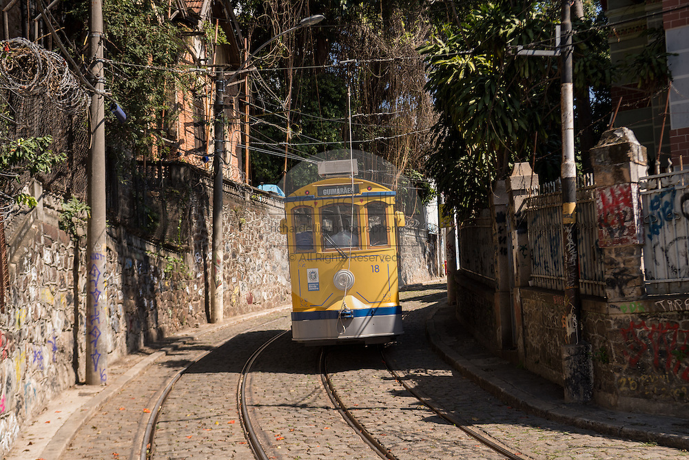 The Santa Teresa bonde historic tram line rides down the hill from the Santa Teresa neighborhood in Rio de Janeiro, Brazil.